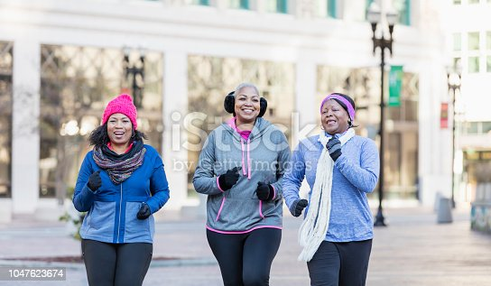 1036366486istockphoto Mature African-American women in city, exercising 1047623674