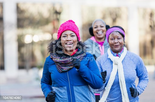 1036366486istockphoto Mature African-American women in city, exercising 1047624092