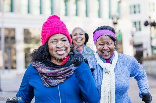 1036366486istockphoto Mature African-American women in city, exercising 1047624176