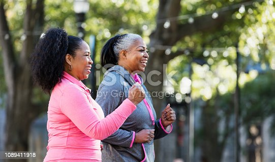 1036366486istockphoto Mature African-American women in city, exercising 1089411918