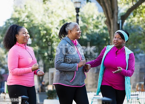 1036366486istockphoto Mature African-American women in city, exercising 1089413428