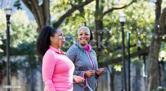 1036366486istockphoto Mature African-American women in city, exercising 1089413436