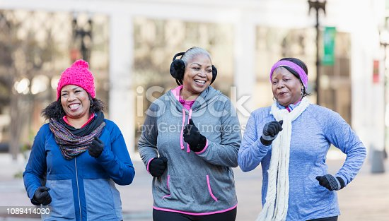 1036366486istockphoto Mature African-American women in city, exercising 1089414030