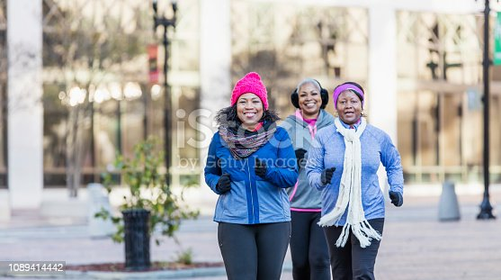 1036366486istockphoto Mature African-American women in city, exercising 1089414442