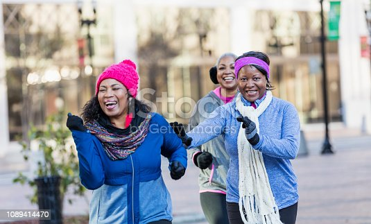 1036366486istockphoto Mature African-American women in city, exercising 1089414470