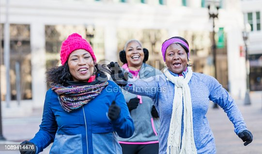 1036366486istockphoto Mature African-American women in city, exercising 1089414476