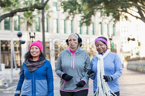 1036366486istockphoto Mature African-American women in city, walking, talking 1036370666