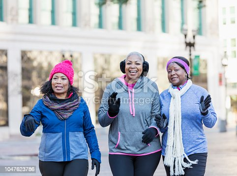 1036366486istockphoto Mature African-American women in city, walking, talking 1047623786