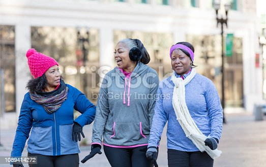 1036366486istockphoto Mature African-American women in city, walking, talking 1089414272