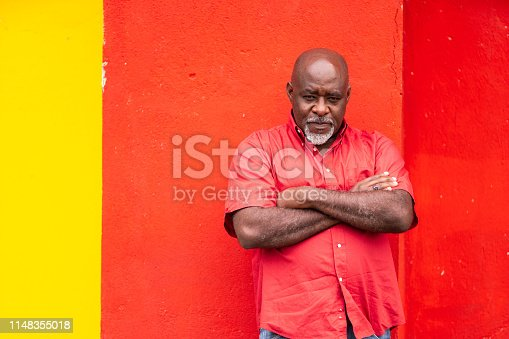 Mature afro man portrait on colorful background
