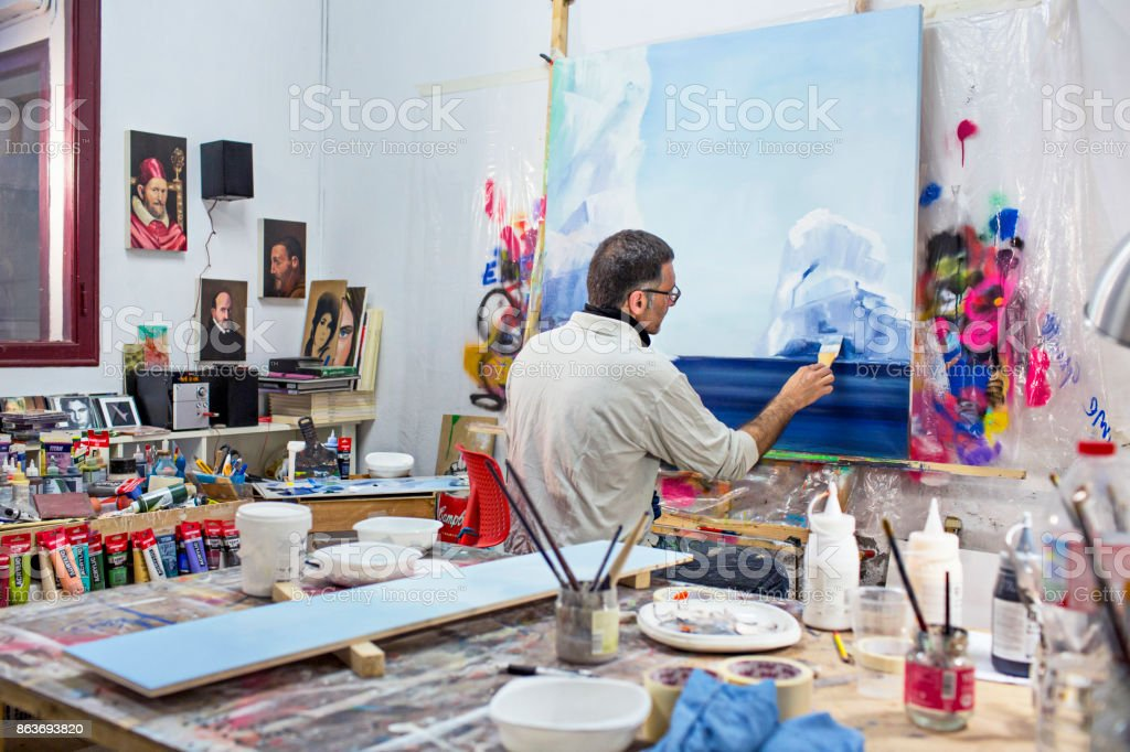 Mature artist businessman on his art studio stock photo