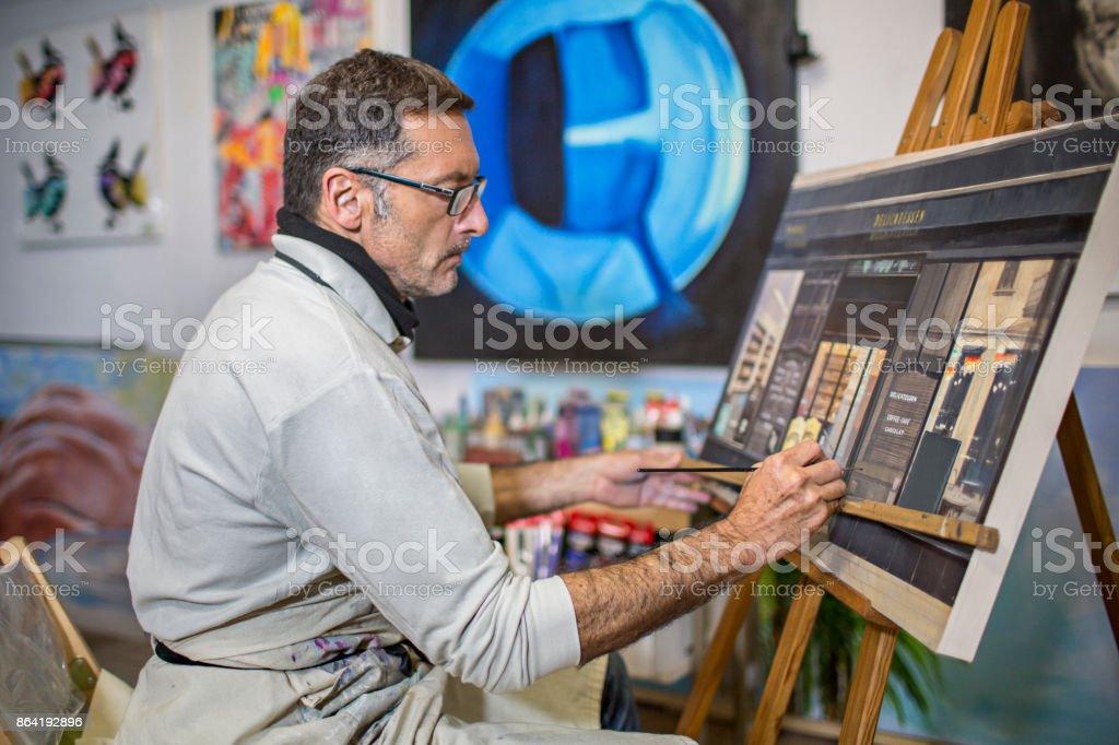 Mature artist man on his art studio royalty-free stock photo