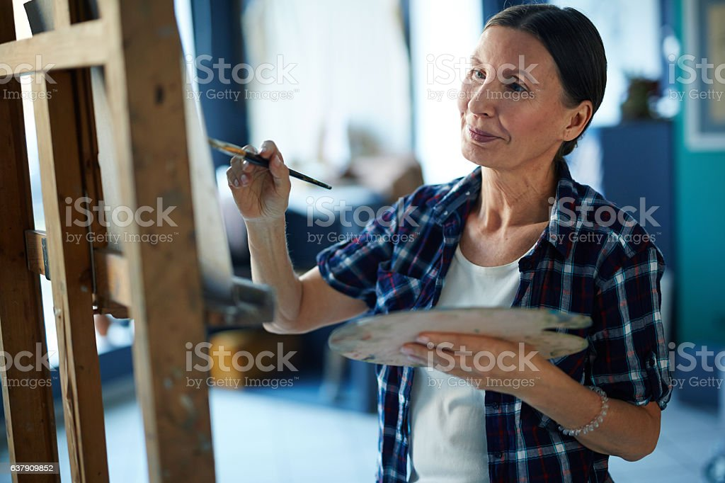Mature artist stock photo