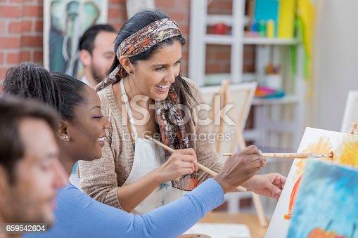 658645980 istock photo Mature artist teaches painting class 659542604