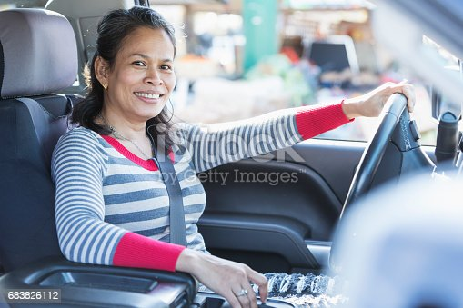 1051147634 istock photo Mature Asian woman driving a pick-up truck 683826112