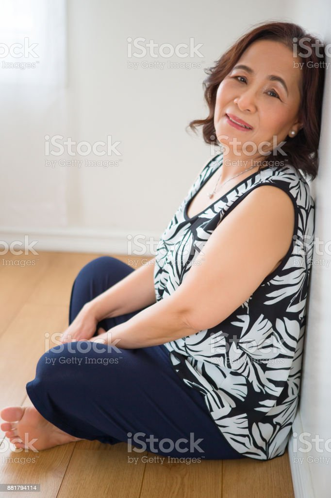 Asian mature showing leg