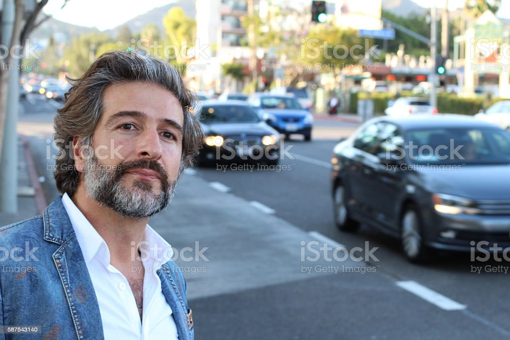 Mature attractive man waiting at the street stock photo