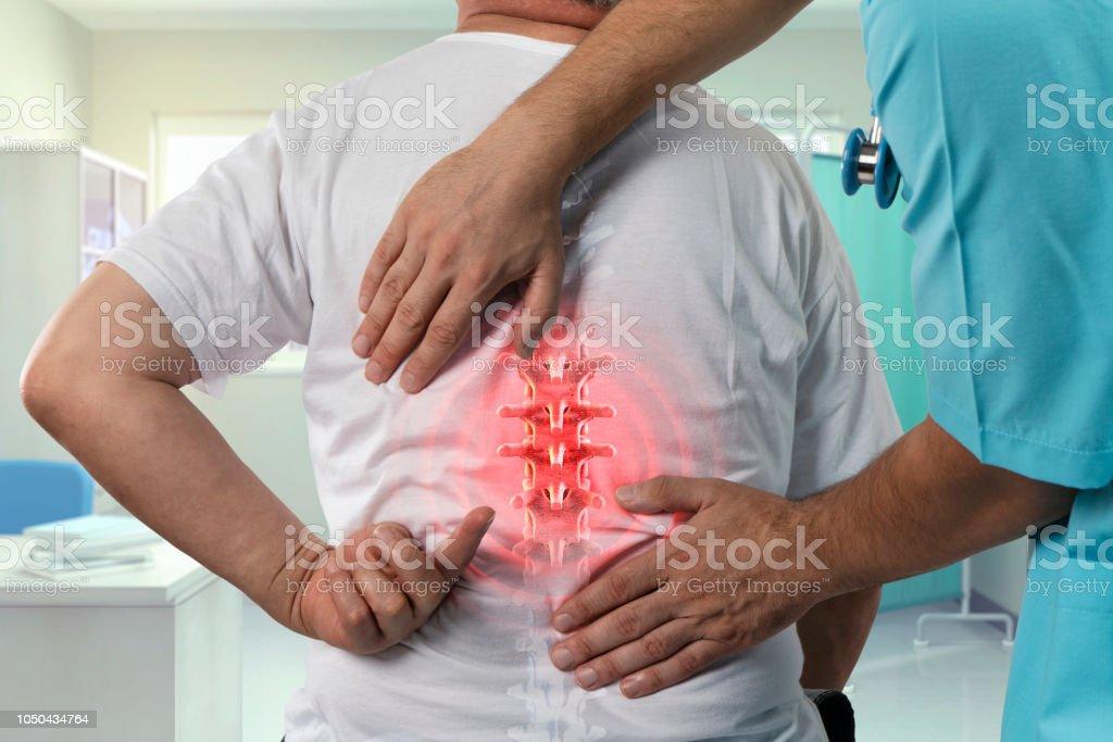 Mature Backache Exam Backache, Medical Exam, Mature Adult, Rear View, Showing 50-59 Years Stock Photo