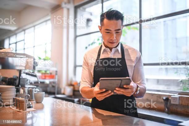 Mature barista using digital tablet at counter picture id1135498552?b=1&k=6&m=1135498552&s=612x612&h=tfaaotmrkqaoegmmazvg w  q3t0zskapncv61i4pta=