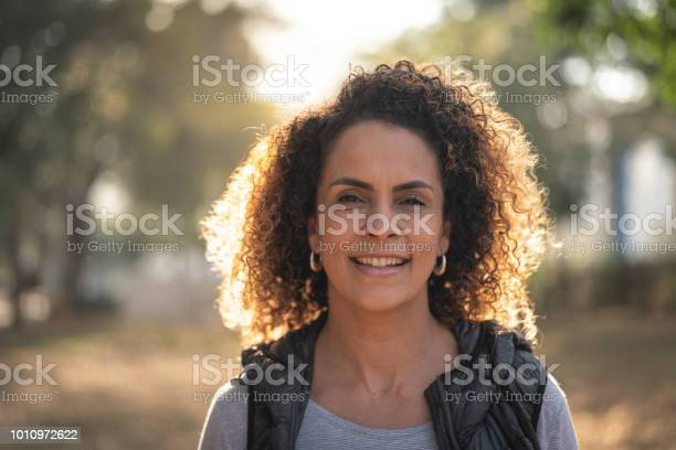 Mature beautiful curly hair woman looking at camera picture id1010972622?b=1&k=6&m=1010972622&s=612x612&h=fe mevby8auglcaaz v1isaf11giatifro37kca6gpk=