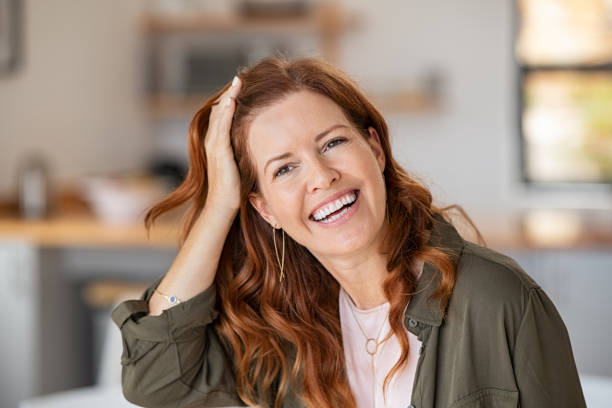 Mature beautiful woman laughing stock photo