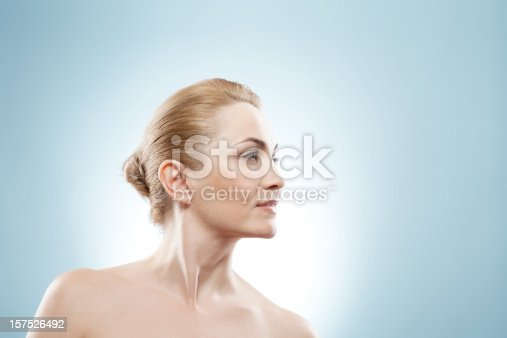 istock Mature beauty looking into the corner. 157526492