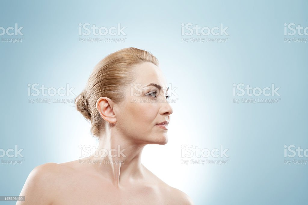 Mature beauty looking into the corner. stock photo