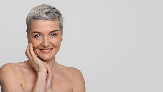 Mature women smiling nude Mature Beauty Portrait Of Charming Nude Middleaged Woman Touching Her Skin Stock Photo Download Image Now Istock