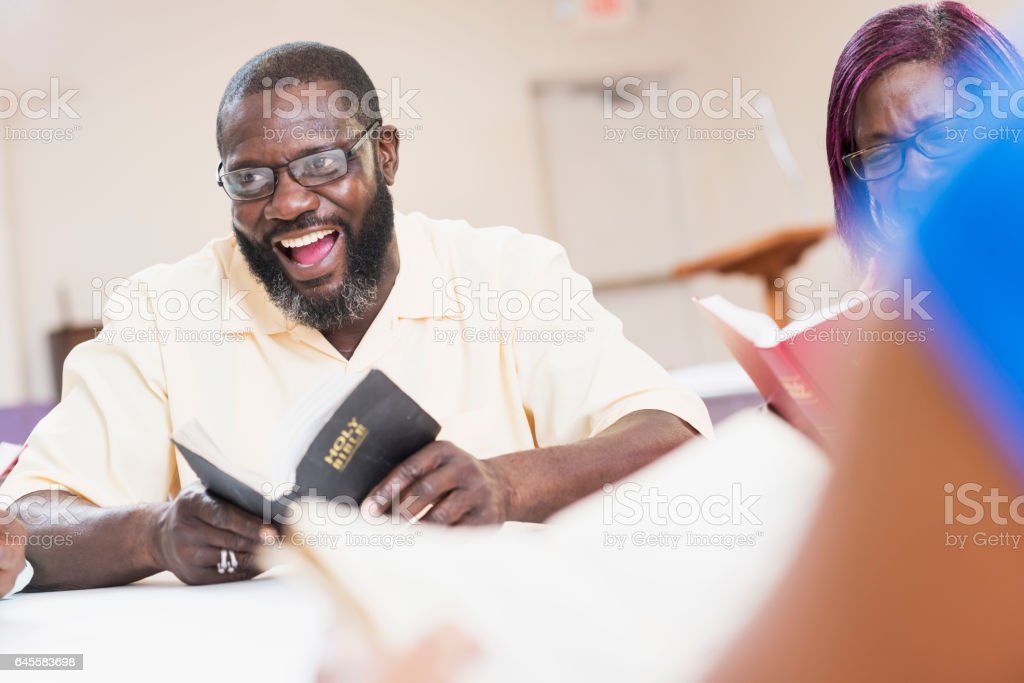 Mature black man speaking in bible study meeting stock photo