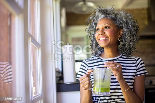istock Mature Black Woman Drinking a Green Smoothie 1136640691