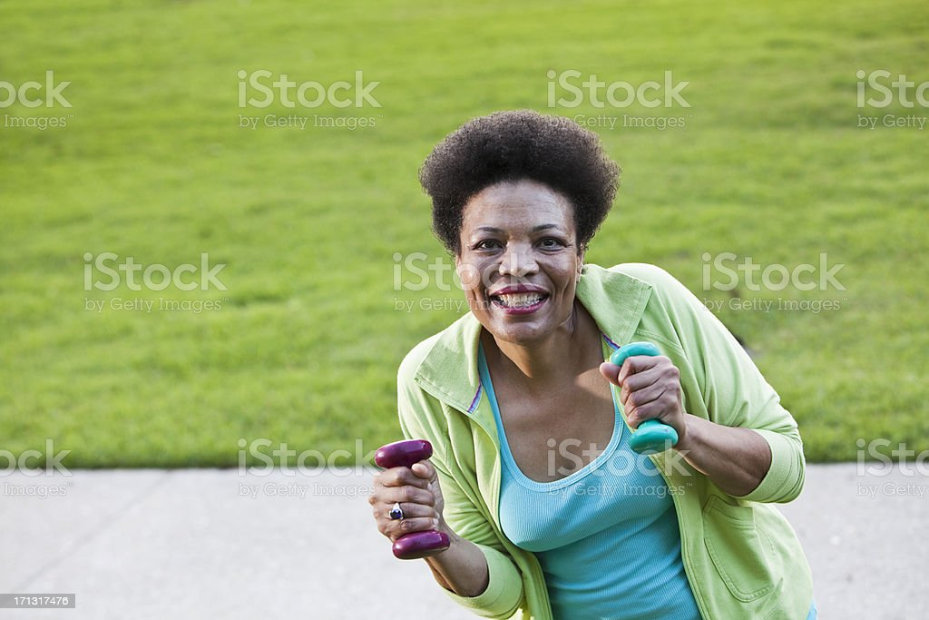 Mature black woman exercising stock photo