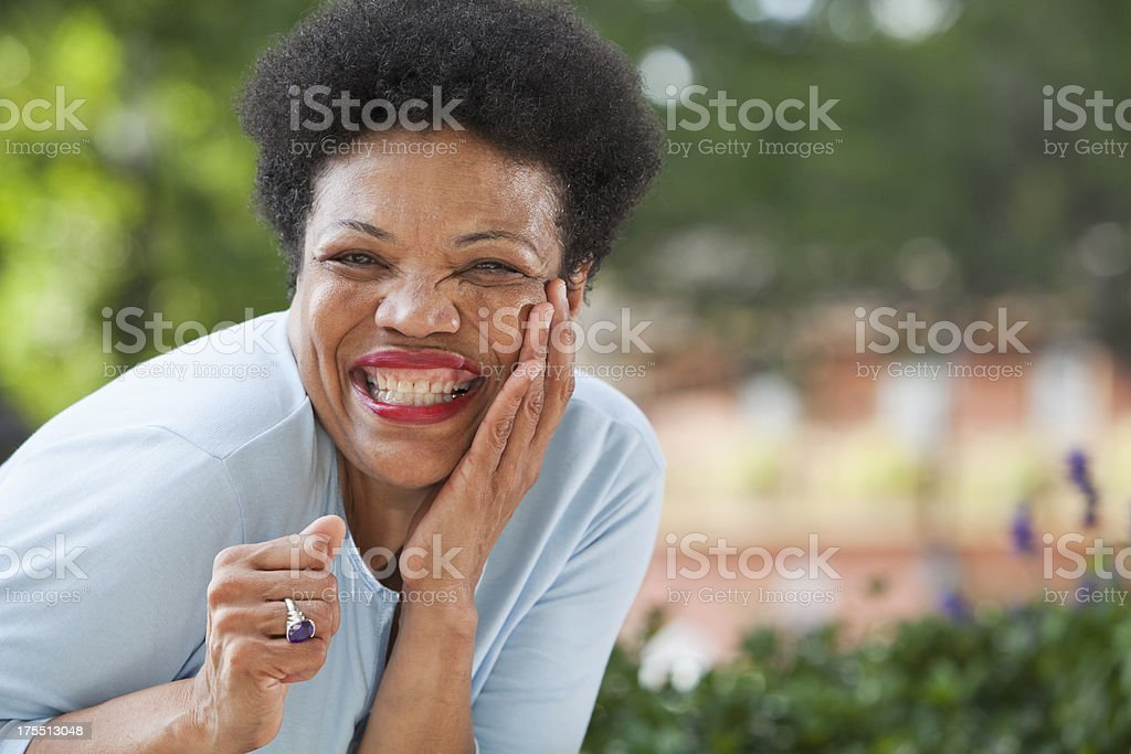 Mature black woman having fun stock photo