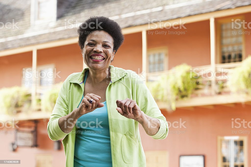 Mature black woman smiling outside stock photo