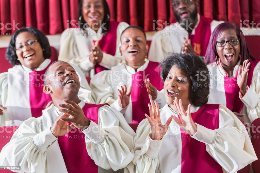 Mature black women and men singing in church choir stock photo