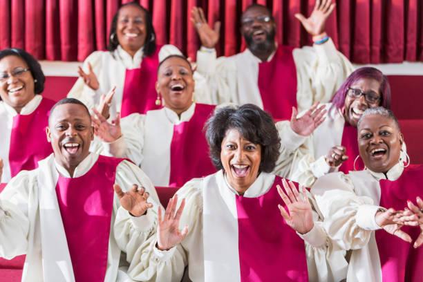 Mature black women and men singing in church choir stock photo