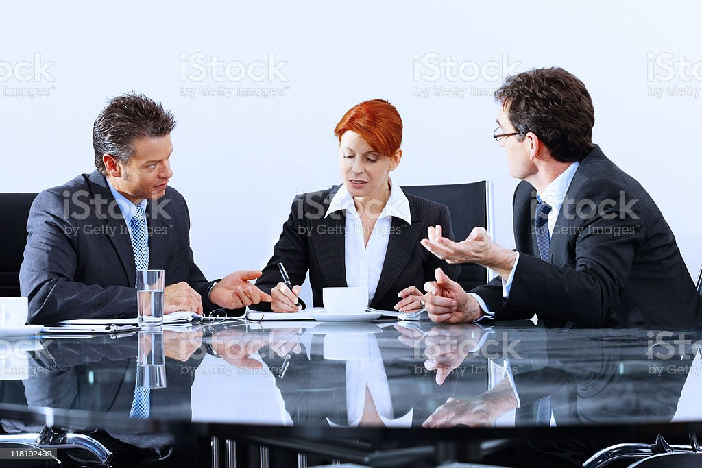 mature Business associates brainstorming in modern office royalty-free stock photo