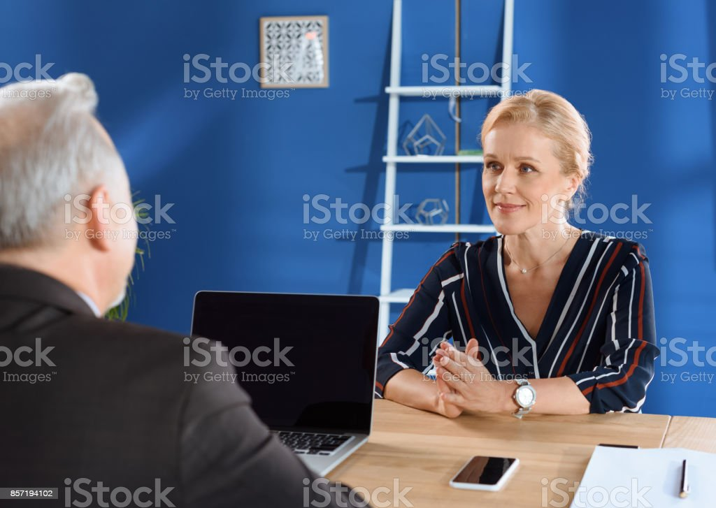 mature business colleagues stock photo