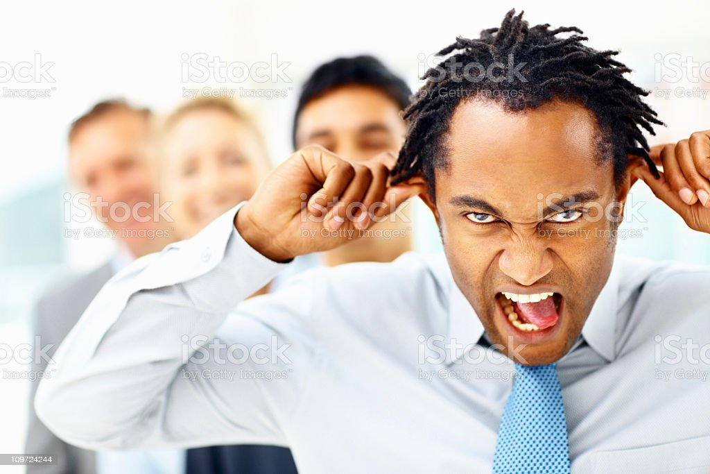 Mature, business executive with funny facial expression royalty-free stock photo
