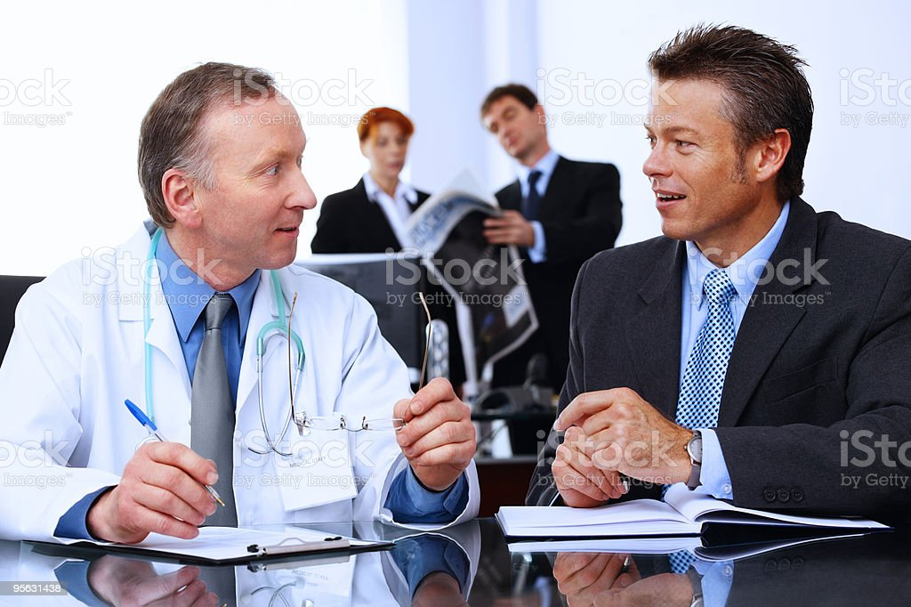 Mature Business group talking to a doctor in modern office - Royalty-free 40-49 Years Stock Photo