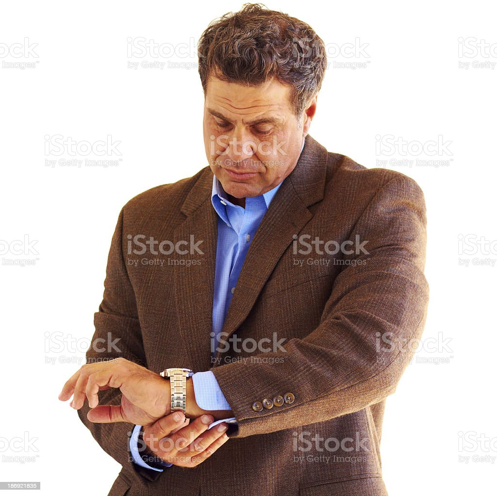 Mature Business Male Checking The Time royalty-free stock photo