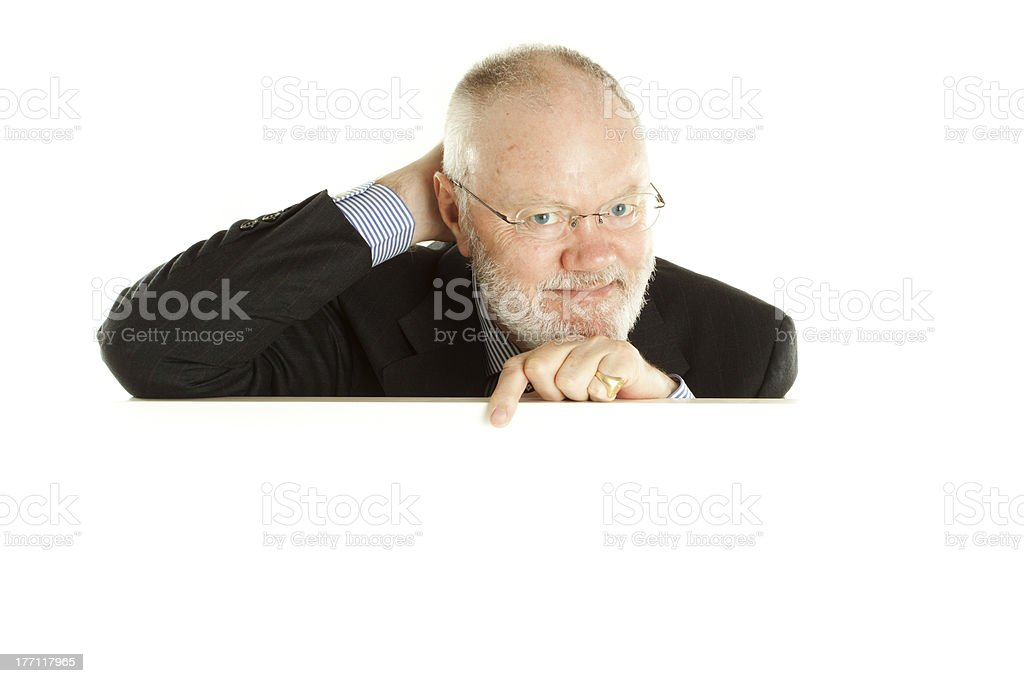 Mature business man behind banner royalty-free stock photo