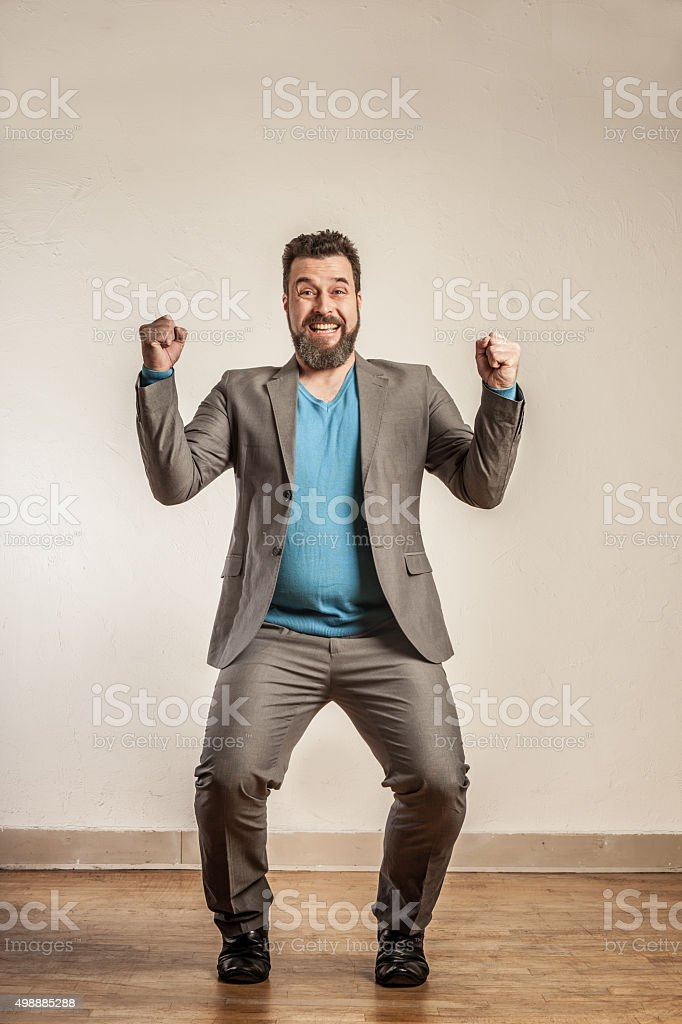 Mature business man cheering enthusiastically stock photo