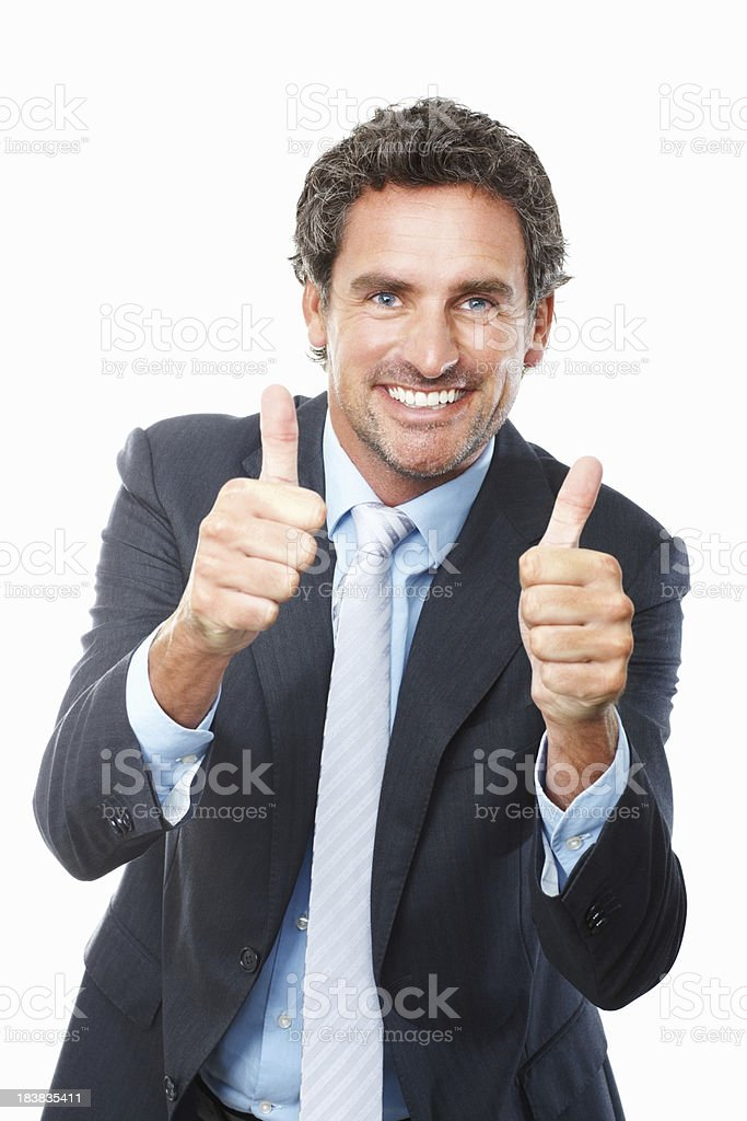 Mature business man giving thumbs up royalty-free stock photo