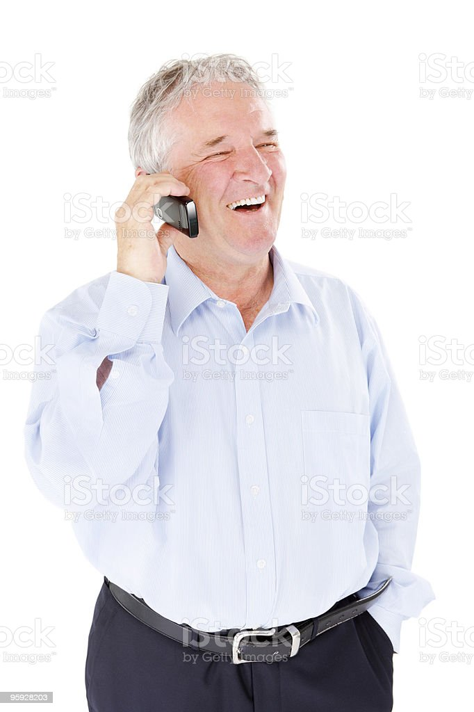 Mature business man holding cellphone on white background royalty-free stock photo