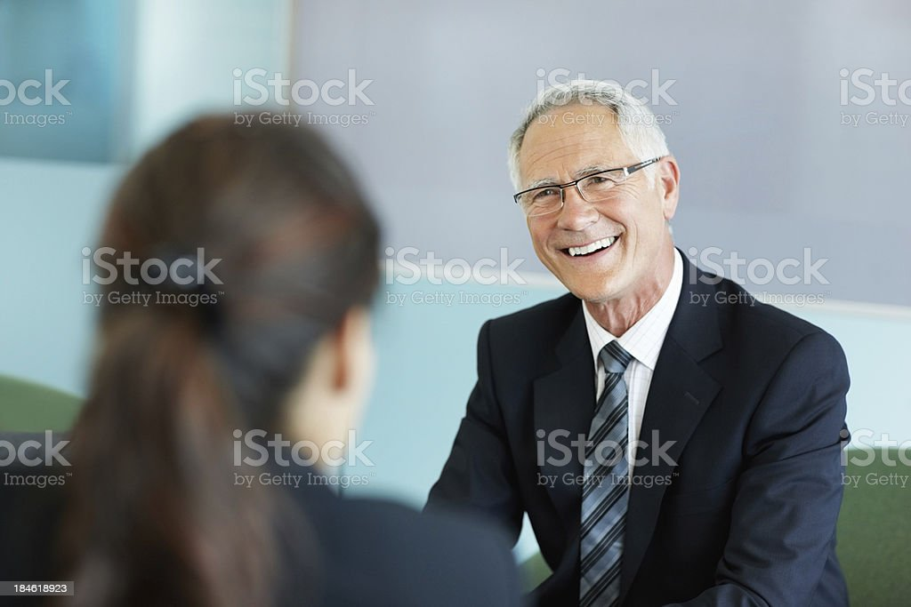 Mature business man listening royalty-free stock photo
