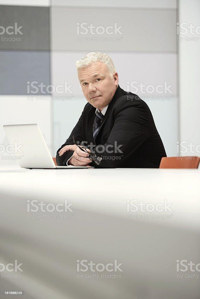 Mature business man on laptop stock photo