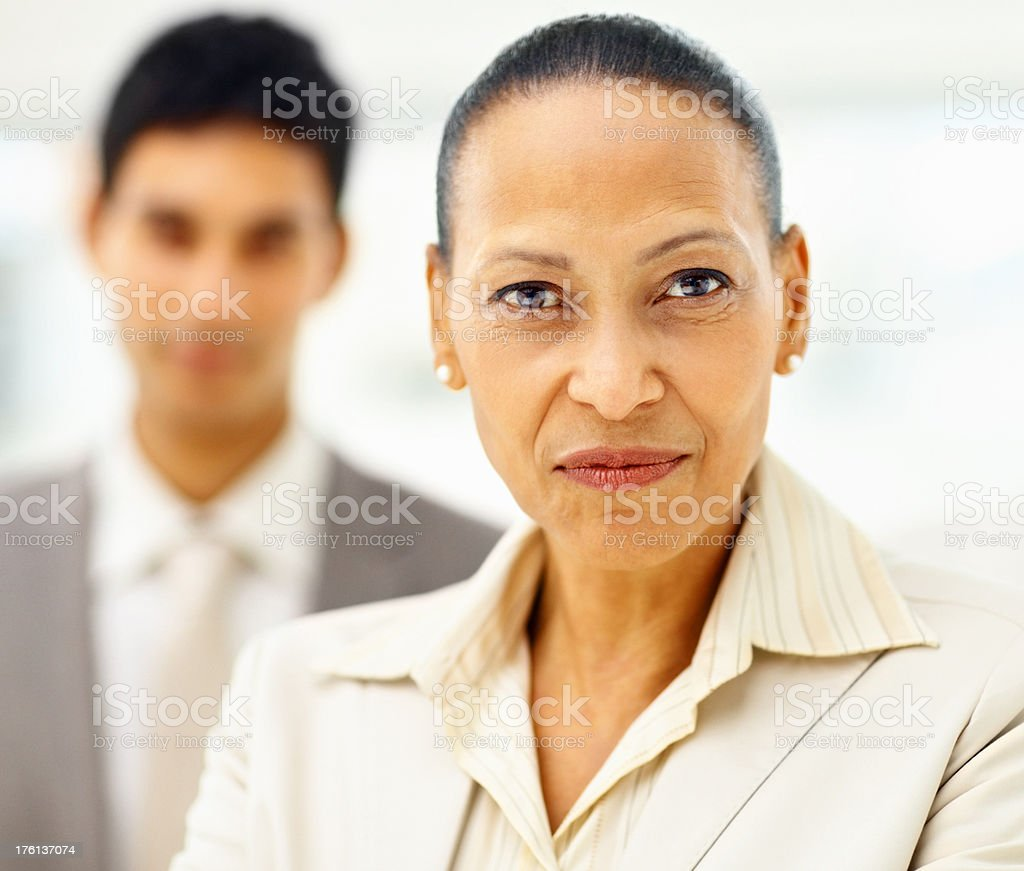 Mature business man with colleague at the back royalty-free stock photo