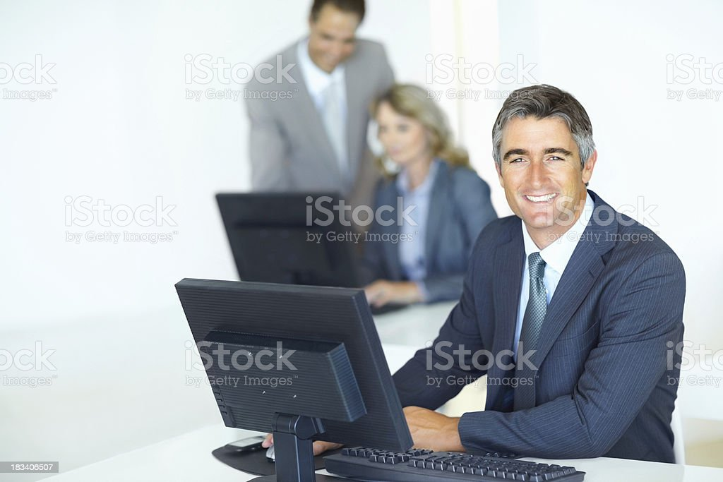 Mature business man working on computer royalty-free stock photo