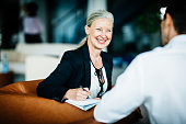 Mature Business Owner Pleased While Talking To Employee