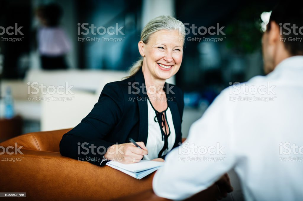 Mature Business Owner Pleased While Talking To Employee stock photo